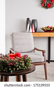 Bright grey upholstered chair in advent decoration