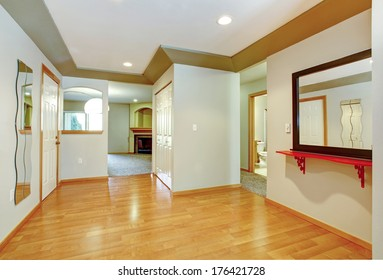 Bright hallway with hardwood floor, ivory walls and white with olive ceiling
