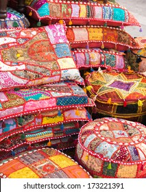 Bright handmade pillows selling on a local asian market in Abu Dhabi
