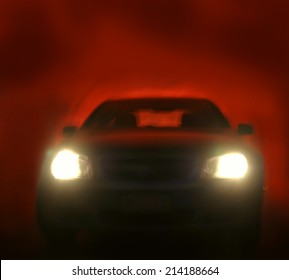 Bright headlights on car. Red background