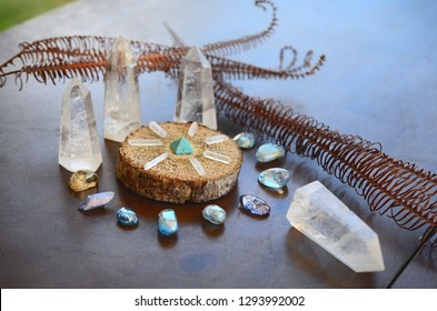 Bright, healing crystals and palo santo. Mystical, low exposure macro photo of crystals. Healing stones, witchy decoration. Wiccan alter, bohemian colors, crystal witchcraft.
