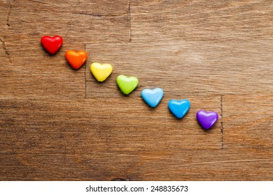 Bright hearts on wooden background