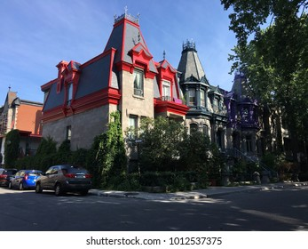 Bright and historic houses boarding the Park of Napolean in the Latin Quarter of Montreal, Quebec.