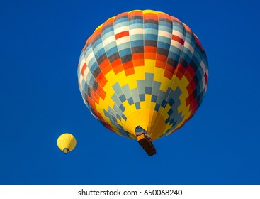 Bright  hot air balloons at blue sky background - composition with two colorful balloons for your idea of dream, happiness or holidays. Beautiful travel concept for your vacation at vivid colors.