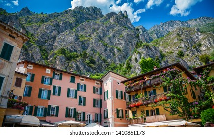 bright houses on a central square of Limone sul Garda, Lake Garda, Italy