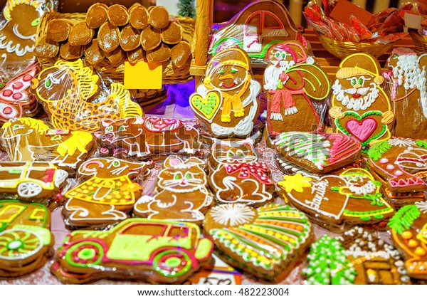 Bright icing on top of the gingerbreads of various sizes photographed at the Christmas Market in Riga, Latvia. It is one of the most traditional sweet treats in different countries.