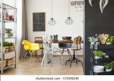 Bright interior with communal table and chairs