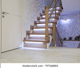 Bright interior with oak ladder with LED backlighting