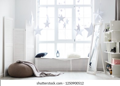 Bright interior, white window sill, christmas window and gifts