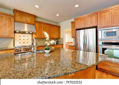 Bright Inviting kitchen features granite counters, oversized kitchen island and stainless steel appliances. Northwest, USA