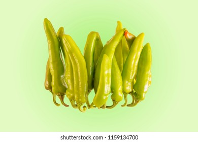 Bright Italian chili pepper called friggitello , studio shot ,colored background