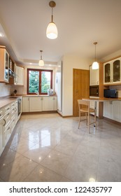 Bright kitchen with small TV, vertical view