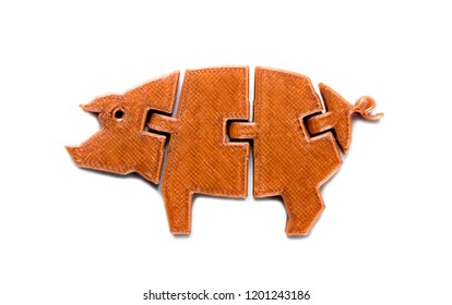 Bright light brown object in shape of pig toy printed on 3d printer isolated on white background. Fused deposition modeling, FDM. Concept modern progressive additive technology for 3d printing.