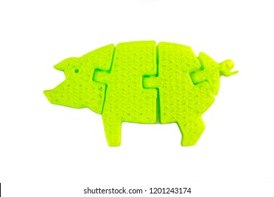 Bright light green object in shape of pig toy printed on 3d printer isolated on white background. Fused deposition modeling, FDM. Concept modern progressive additive technology for 3d printing.