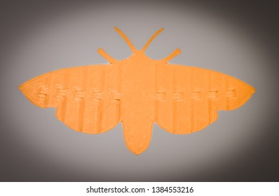 Bright light orange object in shape of butterfly toy printed on 3d printer isolated on white background. Fused deposition modeling, FDM. Concept modern progressive additive technology for 3d printing.