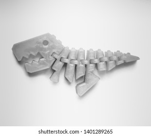 Bright light pink object in shape of dinosaur toy printed on 3d printer isolated on white background. Fused deposition modeling, FDM. Concept modern progressive additive technology for 3d printing.