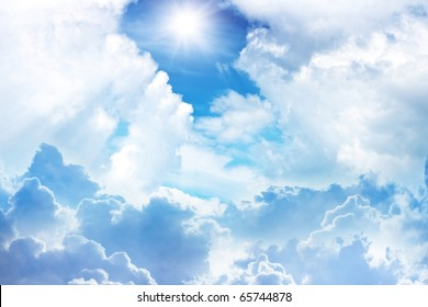 Bright light from sun, blue sky, white clouds
