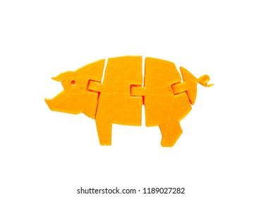 Bright light yellow object in shape of pig toy printed on 3d printer isolated on white background. Fused deposition modeling, FDM. Concept modern progressive additive technology for 3d printing.