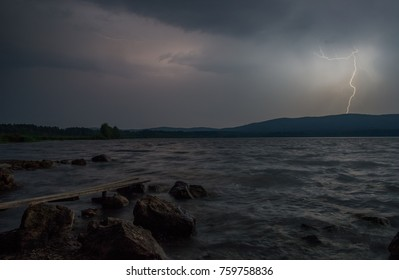 Bright lightning on the shore of the lake