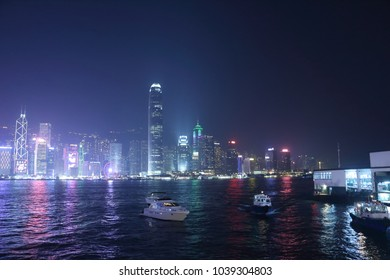 Bright lights from tall buildings fills the the skyline of Hong Kong in the evening.