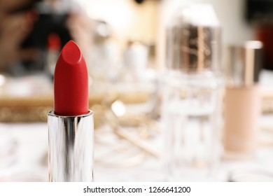 Bright lipstick on blurred background, closeup. Space for text