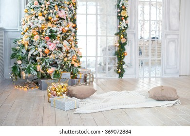 Bright living room decorated with christmas tree and presents for new year party celebration. Indoor interior.