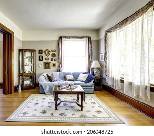 Bright living room interior with antique furniture in old american house