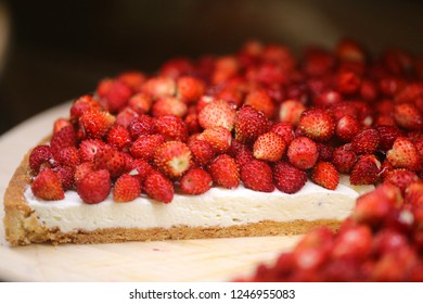 Bright macro photo of beautiful delicious strawberry berry cheesecake on a shop window