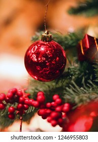 Bright macro photo of a beautiful red New Year's ball on the Christmas tree