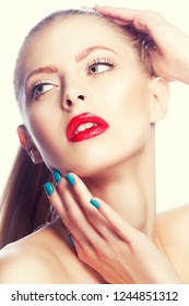 Bright model girl beauty face with red lips make-up, hands near face, clean skin