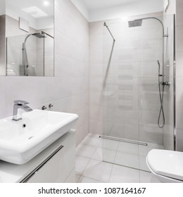 Bright, modern and elegant white bathroom with tiled walk-in shower