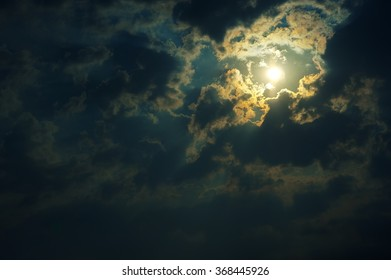 bright moon in the clouds at night