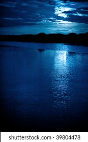 bright moonlight and cloudscape over coastline water