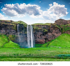 Bright morning view of Seljalandfoss Waterfall on Seljalandsa river in summer. Colorful summer scene of Iceland, Europe. Beauty of nature concept background.