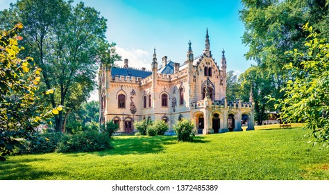 Bright morning view of Sturdza castle. Picturesque summer scene of the green park in Miclauseni monastery. Colorful landscape of Romania, Europe. Traveling concept background.