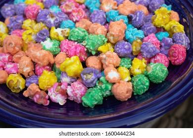 bright multi colored popcorn on a blue plate