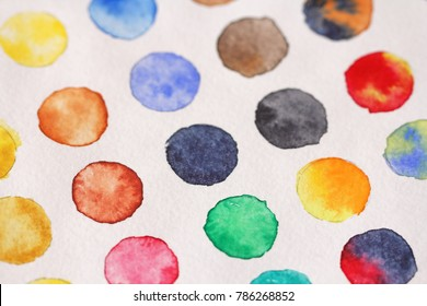 Bright multicolored circles of watercolors. Paper background. Background for decoration and your design. Watercolor background from circles. Green, red, yellow, blue, yellow confetti.