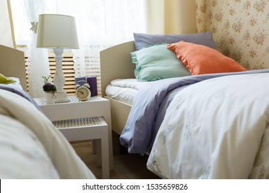 bright multi-colored pillows on the bed in the lounge
