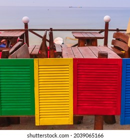 Bright multi-colored small doors as decoration for a beach caf? in the resort town.
