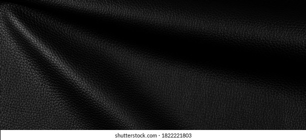 bright natural real black leather with Flexes dark waves background texture abstract close up, horizontal surface studio perfect photography.