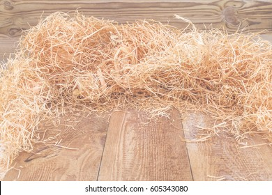 Bright Natural wood shaving wool curls on wooden uncouth Board, rustic background ,  copy space