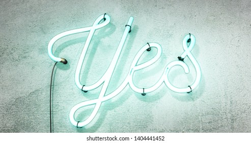Bright neon green sign saying the word Yes