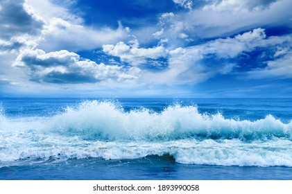 Bright ocean landscape. Sea waves and beautiful sky with white clouds.