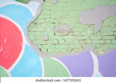 bright old city brick wall with paint layers with nobody