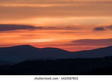 Bright Orange Cloudy Sky Above Blue Ridge Mountain Ridges