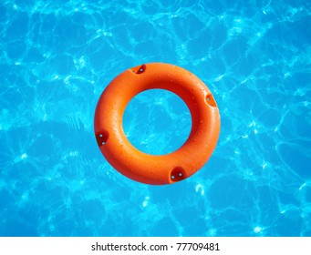 bright orange life buoy floating on the surface of blue water