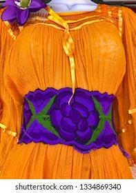 Bright orange Mexican fiesta dress