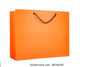 Bright orange paper shopping bag isolated on a white background. One black handle of the bag is visible.