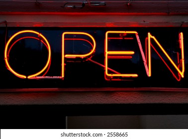 bright orange and red neon bar sign, saying open