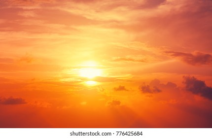 Bright orange sunset sky, natural abstract background and texture